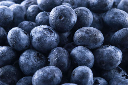 Pile of fresh blueberries with water drops.