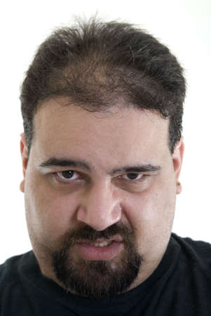 Angry Caucasian man displaying a mean expression with lip curled photo