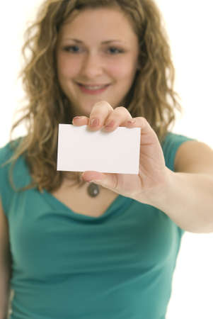 Attractive Caucasian woman holding blank business card. Shallow DOF. Focus on card. photo