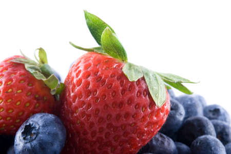 Pile of fresh blueberries with two strawberries on top. Stock Photo - 5693231