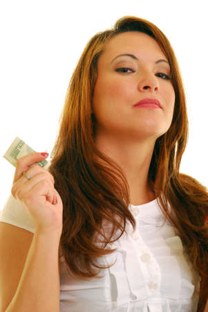 Beautiful Caucasian woman holding American currency photographed against white. photo
