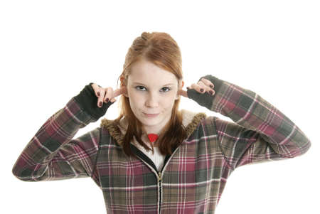 disobey: Annoyed teenage girl with her fingers in her ears Stock Photo