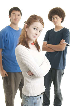multiracial groups: Three teens of different ethnic backgrounds. Focus on Caucasian girl in front