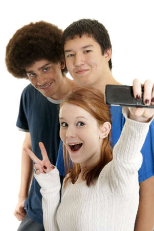 Three teens of different ethnic backgrounds smiling for the camera phone