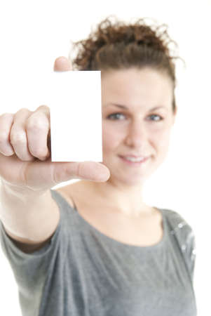 Attractive woman holding blank business card. Focus on hand and card. Stock Photo - 6163200