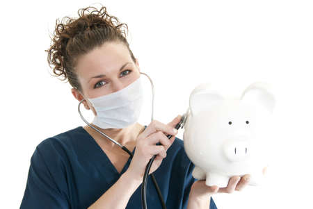 Attractive Caucasian nurse listening to piggy bank Stock Photo - 6163199