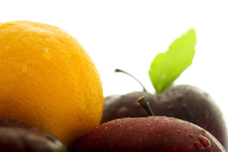 incompatible: An orange sits in the middle of a crowd of apples. Shallow DOF. Focus on top of front apple. Stock Photo