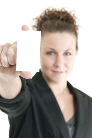 Attractive Caucasian woman holding blank card. Shallow DOF. Focus on card. Stock Photo - 6187160