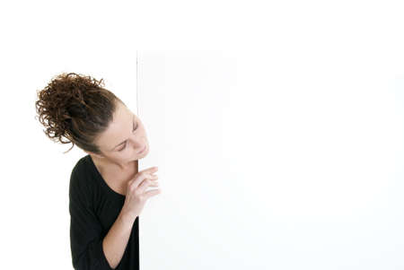 Beautiful Caucasian woman looks at a blank sign with room for copy Stock Photo - 6193328