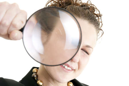 Business woman holding a magnifying glass isolated on white. Focus on face. Stock Photo - 6193321