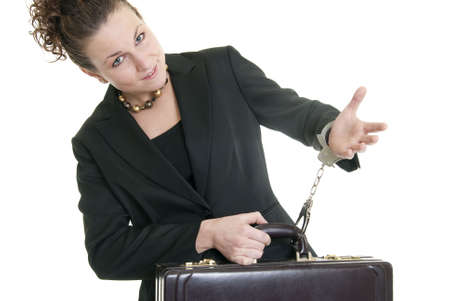 handcuffed: Attractive Caucasian business woman holding a briefcase while handcuffed to it.