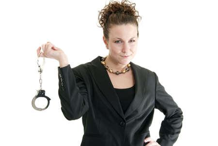 Attractive Caucasian business woman holding a pair of handcuffs Stock Photo - 6264072