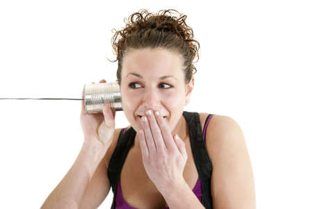 Listening to a funny story on a string telephone Stock Photo - 6305539