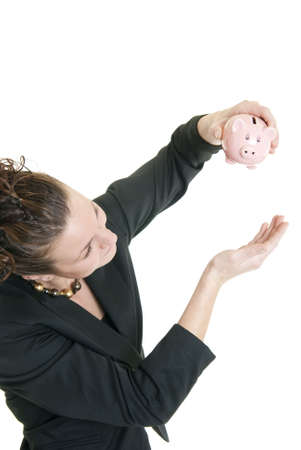Attractive Caucasian woman trying to get money from her piggy bank. photo