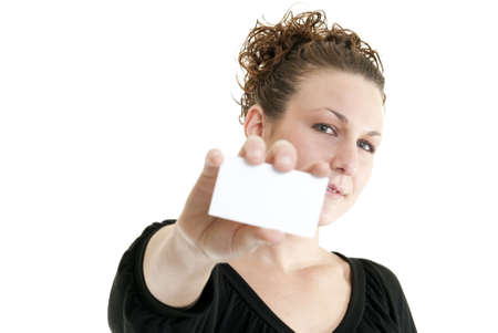 Attractive Caucasian woman holding blank card. Shallow DOF. Focus on face. Stock Photo - 6384853