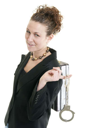 Attractive Caucasian business woman holding a pair of handcuffs Stock Photo - 6436892