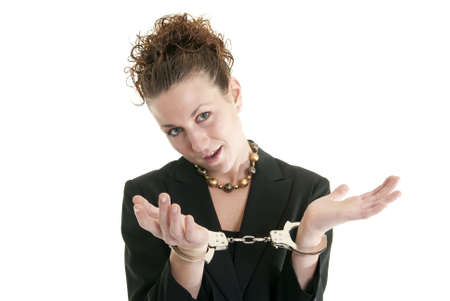 Attractive young woman in suit with handcuffs. Stock Photo - 6474869