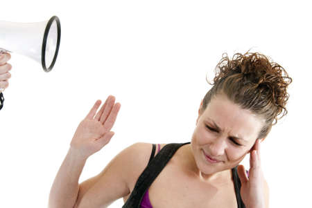 Attractive Caucasian woman being yelled at by someone using a megaphone Stock Photo - 6474871