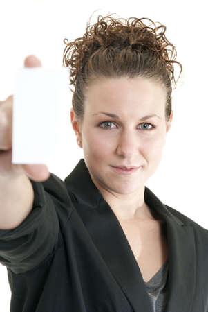 Attractive Caucasian woman holding blank card. Shallow DOF. Focus on face. Stock Photo - 6474877