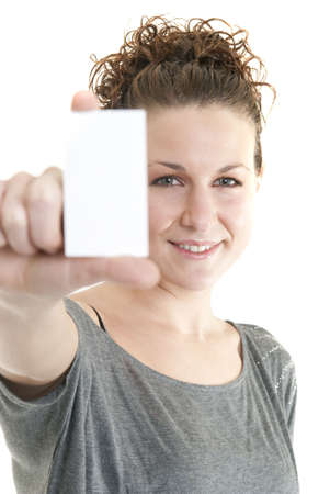 Attractive Caucasian woman holding blank card. Shallow DOF. Focus on face. Stock Photo - 6685674
