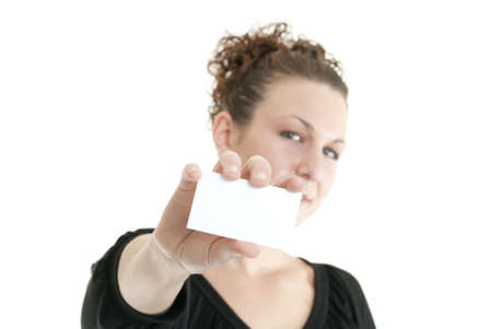 Attractive Caucasian woman holding blank card. Shallow DOF. Focus on card. Stock Photo - 6685673