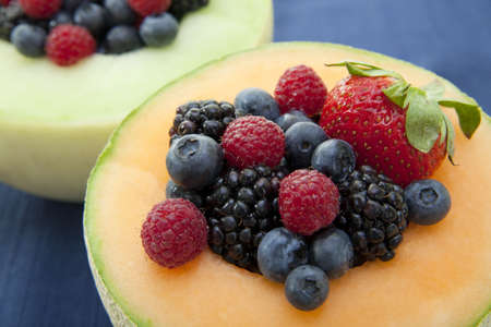 Fresh berries in a bowl made of melon photo
