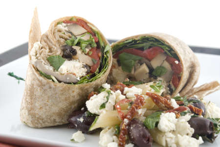 Vegetable wraps on a plate. Shallow DOF. Focus on left wrap. Stock Photo