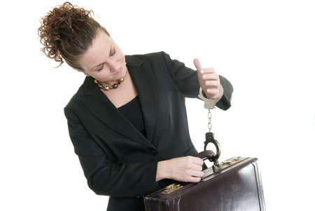 Caucasian business woman holding a briefcase while handcuffed to it. photo