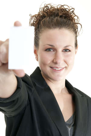 Attractive Caucasian woman holding blank card. Shallow DOF. Focus on face. Stock Photo - 6727080