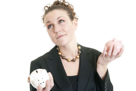 Attractive Caucasian female holding a white and a pink piggy bank making a decision. Stock Photo - 6727078