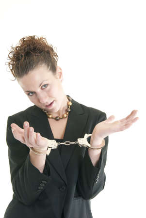 Attractive young woman in suit with handcuffs.