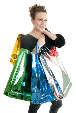 Attractive Caucasian woman holding many shopping bags. photo