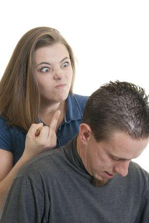 A woman makes a rude gesture at her boyfriend photo