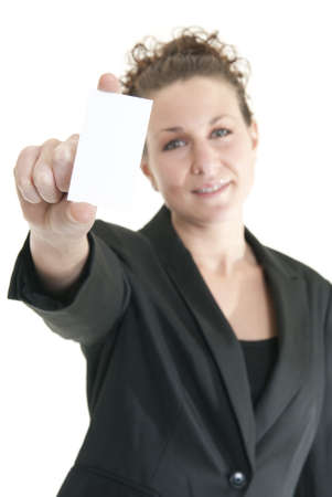 Attractive Caucasian woman holding blank card. Shallow DOF. Focus on card and hand. photo