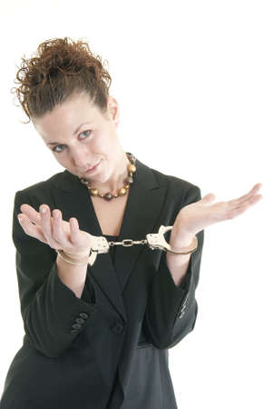 Attractive young woman in suit with handcuffs. Stock Photo - 6967515