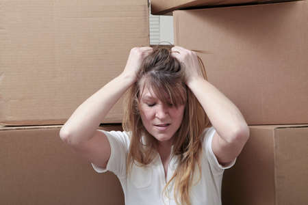 Caucasian woman overwhelmed by the stress of moving
