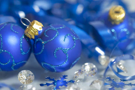 Decorated Christmas bulbs with snowflakes and gems photo