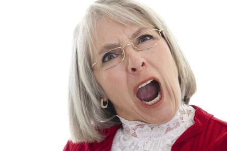 Mature Caucasian woman yelling with an angry expression photo