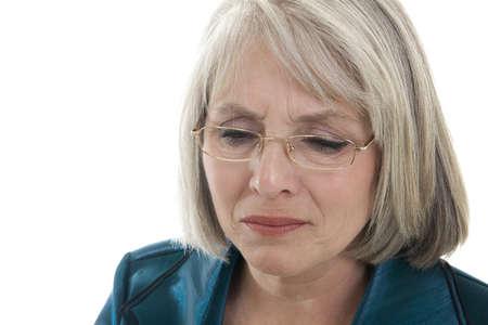 Mature, attractive Caucasian woman grieving