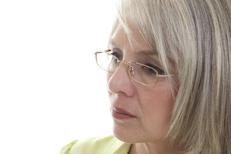 matron: Mature, attractive Caucasian woman with a serious expression on her face. Stock Photo