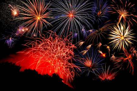 Red, white and blue fireworks against a black sky. Stock Photo - 7220350