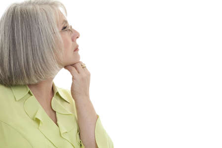 matron: Mature, attractive Caucasian woman looking off into the distance.