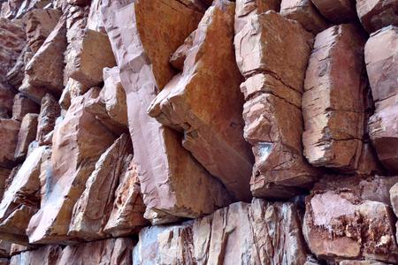 Reddish stone wall