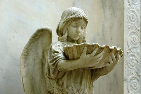 Angel holding bowl