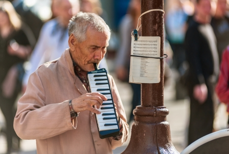 MOSCOW, RUSSIA - APRIL 30: Street musician on Old Arbat - a very popular tourist pedestrian street, in the heart of Moscow. April 30, 2013