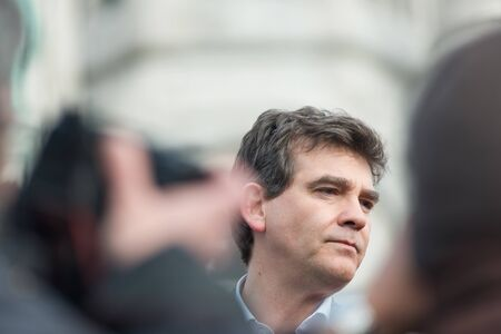 French Minister for Industrial Renewal Arnaud Montebourg supports the made in France and talks to the  employees of the company Blanc de Vosges at Montmartre.Paris, FRANCE-06/04/2013