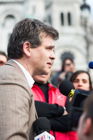 interviewed: French Minister for Industrial Renewal Arnaud Montebourg supports the made in France and is interviewed at Montmartre. Paris, FRANCE-06042013 Editorial