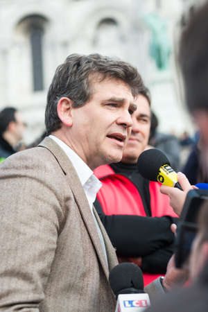 French Minister for Industrial Renewal Arnaud Montebourg supports the made in France and is interviewed at Montmartre. Paris, FRANCE-06/04/2013