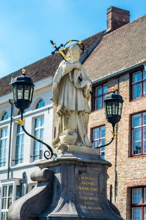 confessor: Sanctus Joannes Nepomucenus statue in Bruges, Belgium Editorial