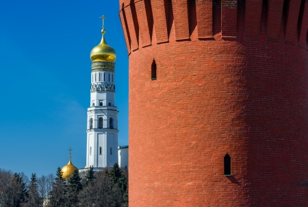 Ivan the Great Bell Tower and Beklemishevskaya  Moskvoretskaya  Tower of Moscow Kremlin  Two loopholes are visible on the tower as black holes  photo
